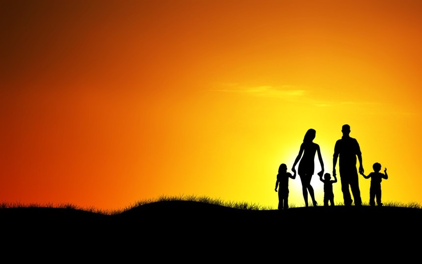 happy family walking on sun set time