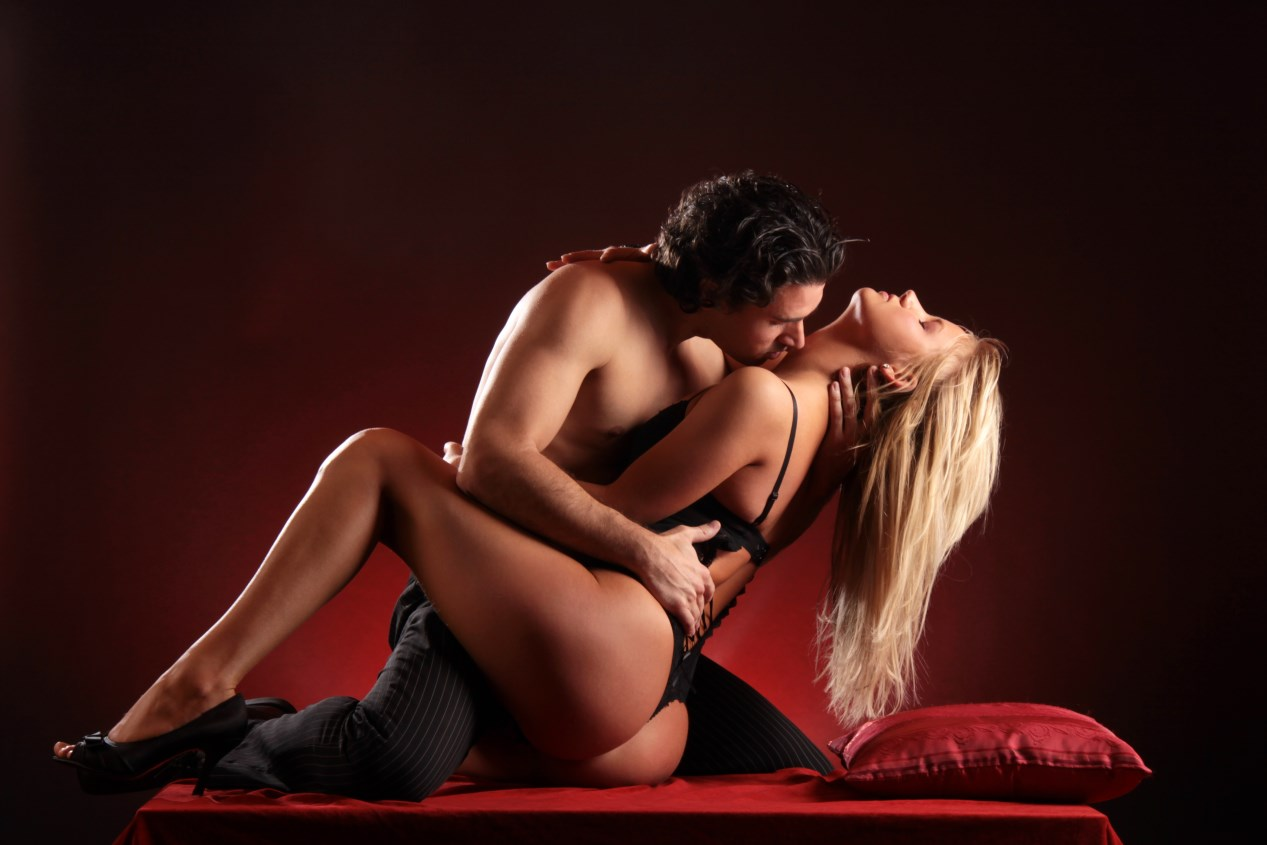 A Young Man With His Arms Round Two Sexy Young Women Stock Photo